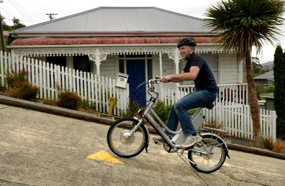 Dunedin AvantiPlus bike mechanic Mac Robertson tests the eZee electric bike up Baldwin St in...