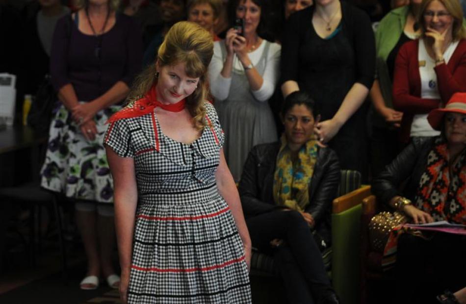 Dunedin Central Library staff member Emma Milburn (top) models a vintage dress during the geek...