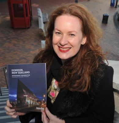 Dunedin City Council business development adviser Chanel O'Brien with a copy of a new Dunedin...