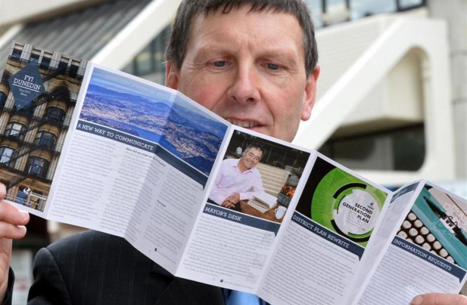 Dunedin City Council communications and marketing manager Graham McKerracher checks  a copy of...