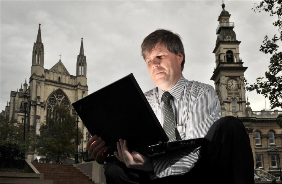 Dunedin City Council customer services agency manager William Robertson uses the free internet...