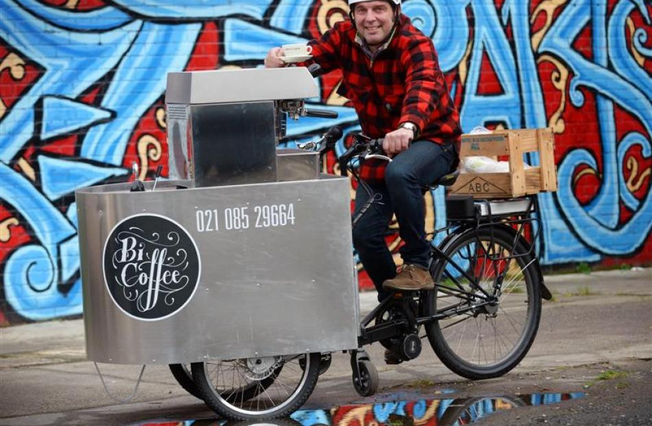 Dunedin entrepreneur Olivier Lequeux with his 150kg mobile espresso tricycle yesterday. Photo by...