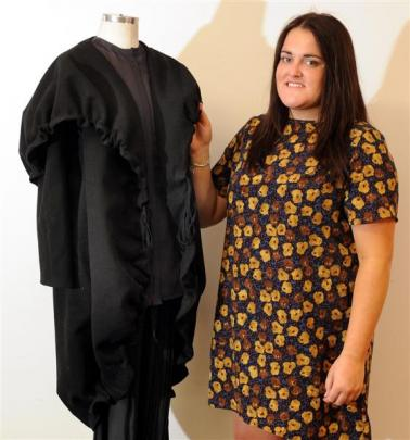 Dunedin fashion graduate Emily Scott is yet to receive her prize after winning the inaugural...