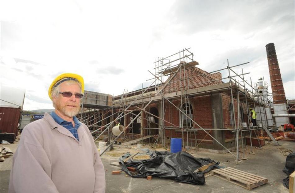 Dunedin Gasworks Museum Trust Board member John Heaven is pleased by the progress of restoration...