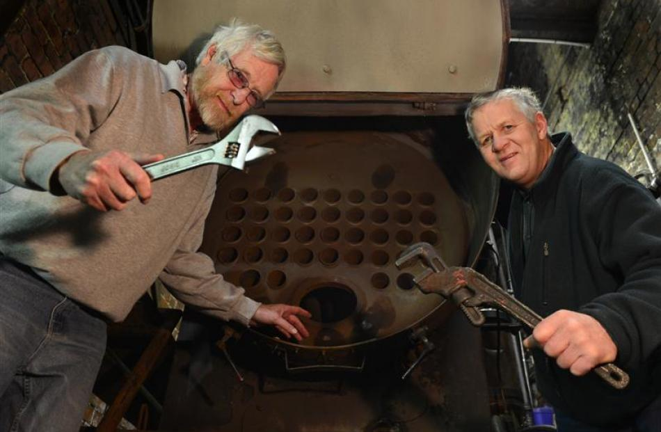 Dunedin Gasworks Museum trustees John Heaven (left) and Tom Galletly examine the gasworks' boiler...