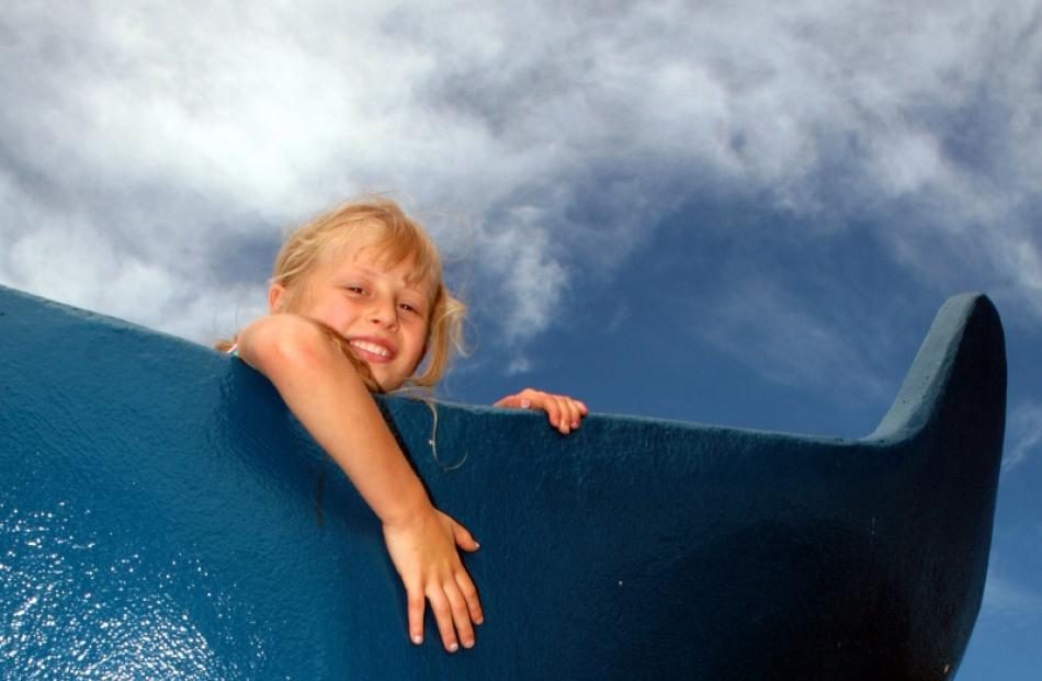 Dunedin girl Lizzy Park (7) climbs to the top of the whale tail at Marlow Park. A new school of...