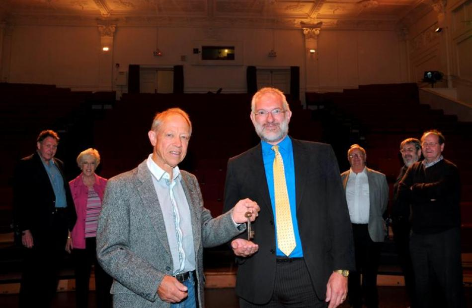 Dunedin Opera Company chairman Murray Davidson hands the keys of the Mayfair Theatre to Mayfair...