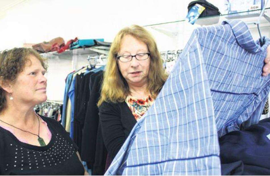 Dunedin Salvation Army Family Store manager Jane Orbell and volunteer Robyn Tomson inspect some...