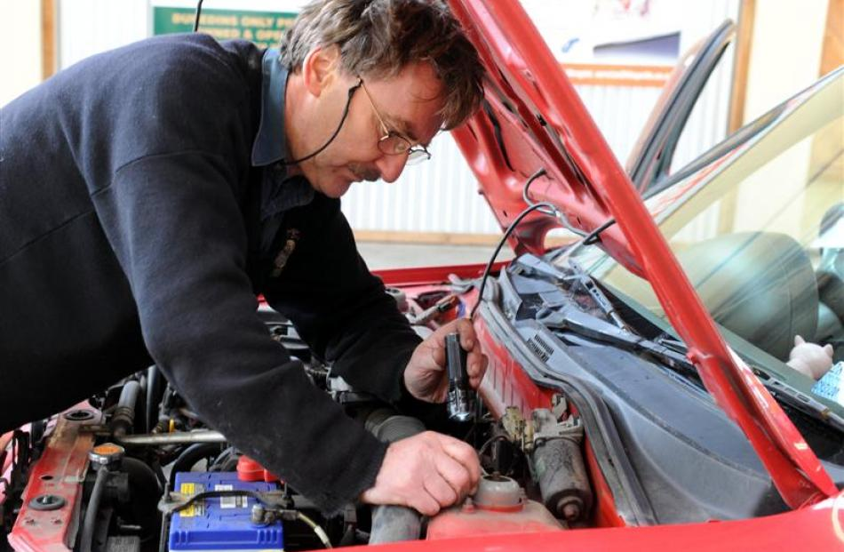 Dunedin Warrant of Fitness Centre inspector Phil Ward  checks a car yesterday. Photo by Craig...