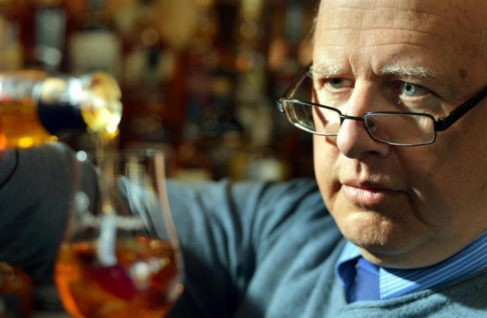 Dunedin whisky enthusiast John Eckhoff samples a dram at Meenan and Company yesterday. Photo by...