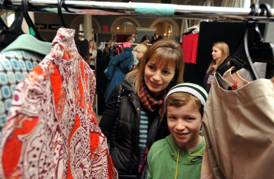 Dunedin woman Rebecca Meikle and her  son Sam browse  through clothing racks at the iD Designer...
