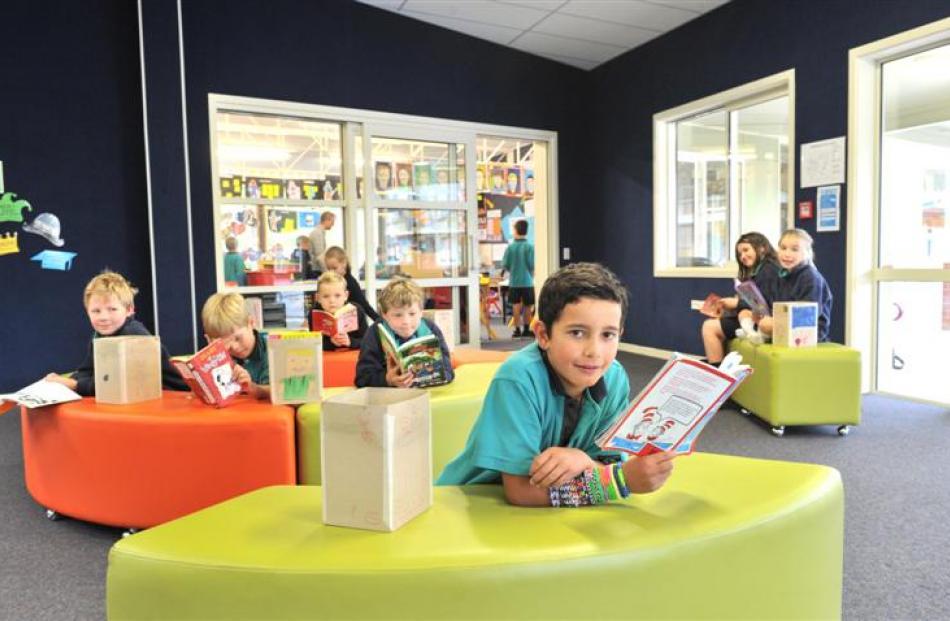 East Taieri School pupil Luke Marsden (8, front) reads a book in the school's new learning hub,...