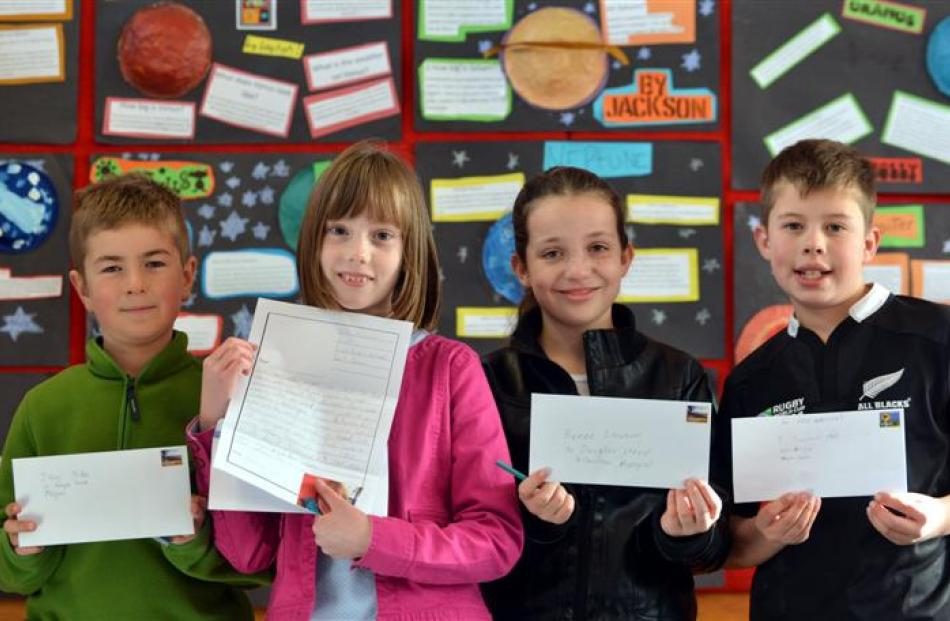 East Taieri School pupils (from left) Logan Hay (10), Kate McEwan (9), Holly Crawford (9) and...