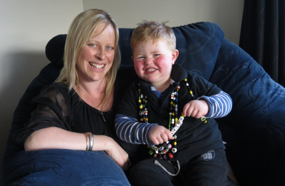 Rebecca Michelle and son Xavier (2), wearing his 'Beads of Courage', relax at home in Mosgiel....