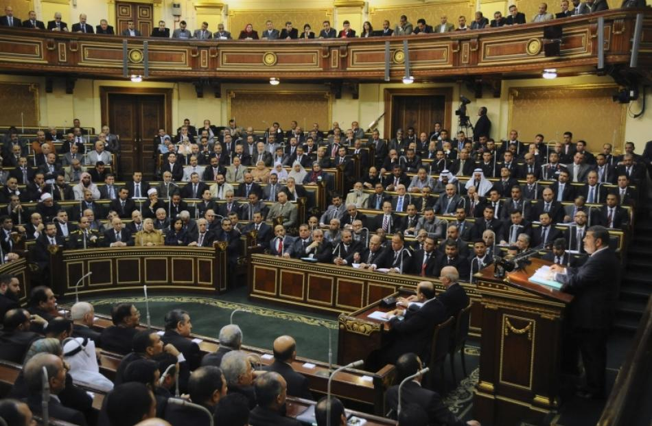 Egyptian President Mohamed Mursi delivers a speech to the Shura Council, or upper house of...