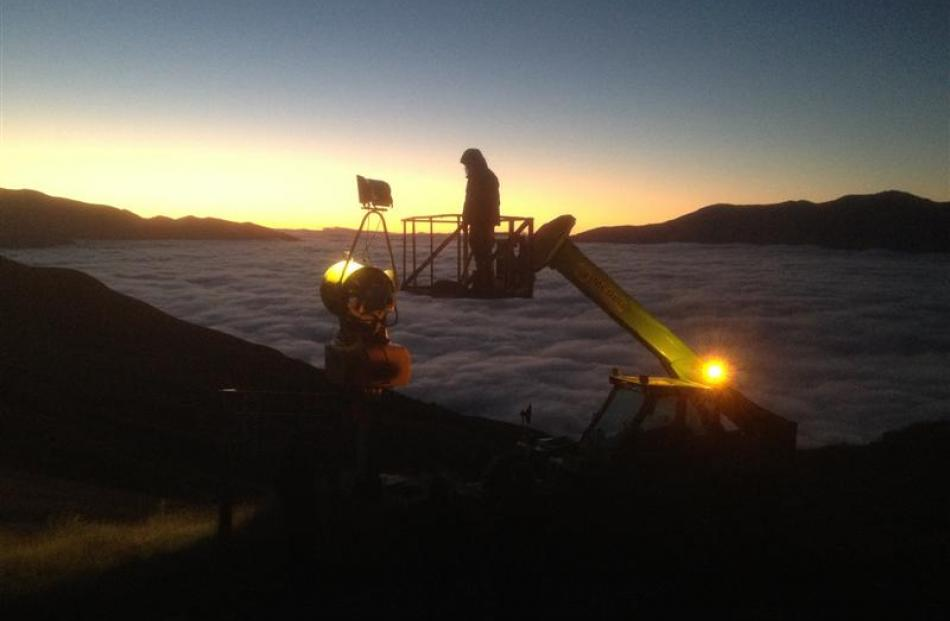 Electrician Wesley Sayer, of Queenstown, does some early morning testing of the new  metal halide...