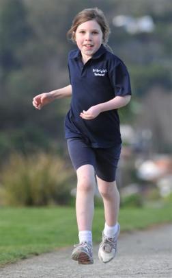 Ella Reilly (8) trains in Dunedin yesterday for the children's marathon challenge next month....