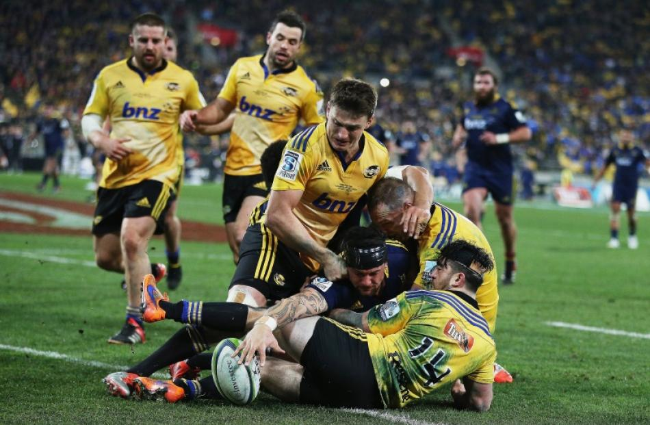 Elliot Dixon of the Highlanders dives over to score a try during the Super Rugby Final match...