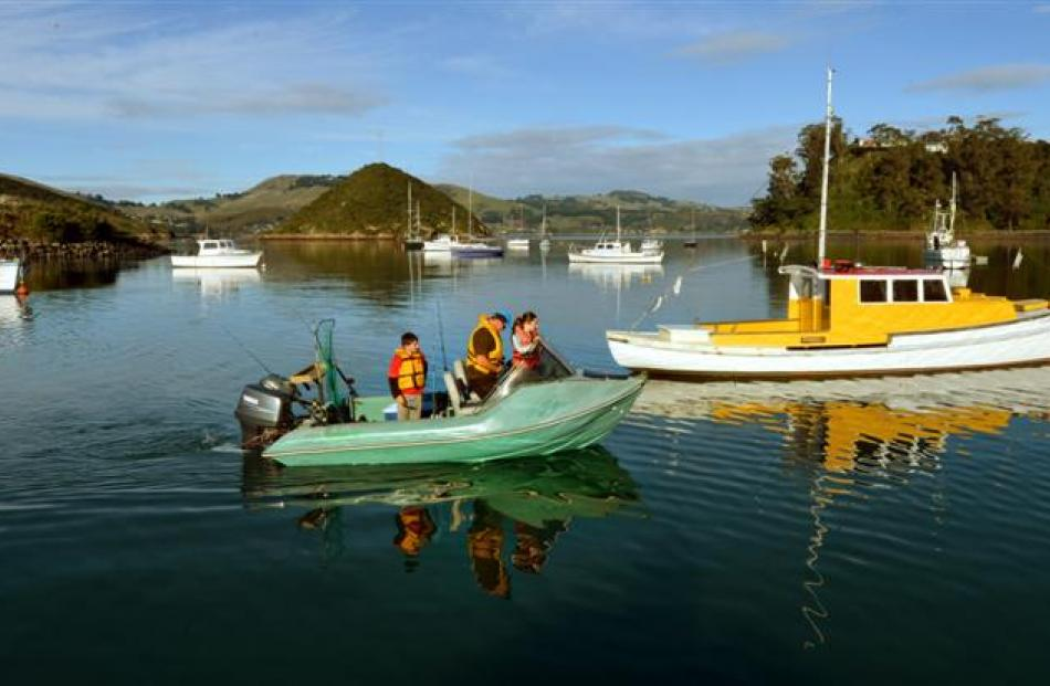 Embarking on a fishing trip from Back Beach in Dunedin yesterday are (from left) Hayden (10),...