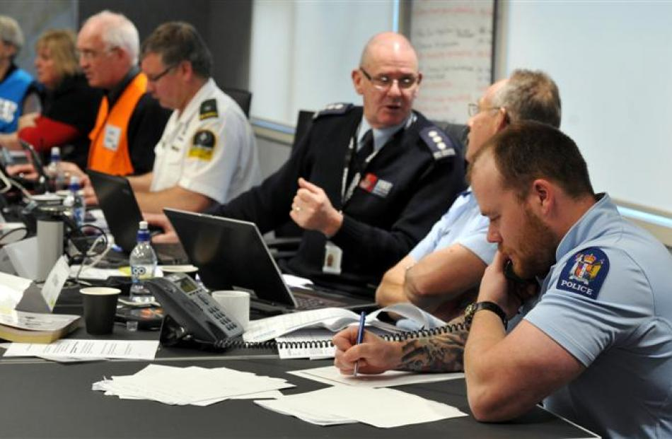 Emergency and social services staff respond to the information on damage from a major simulated...