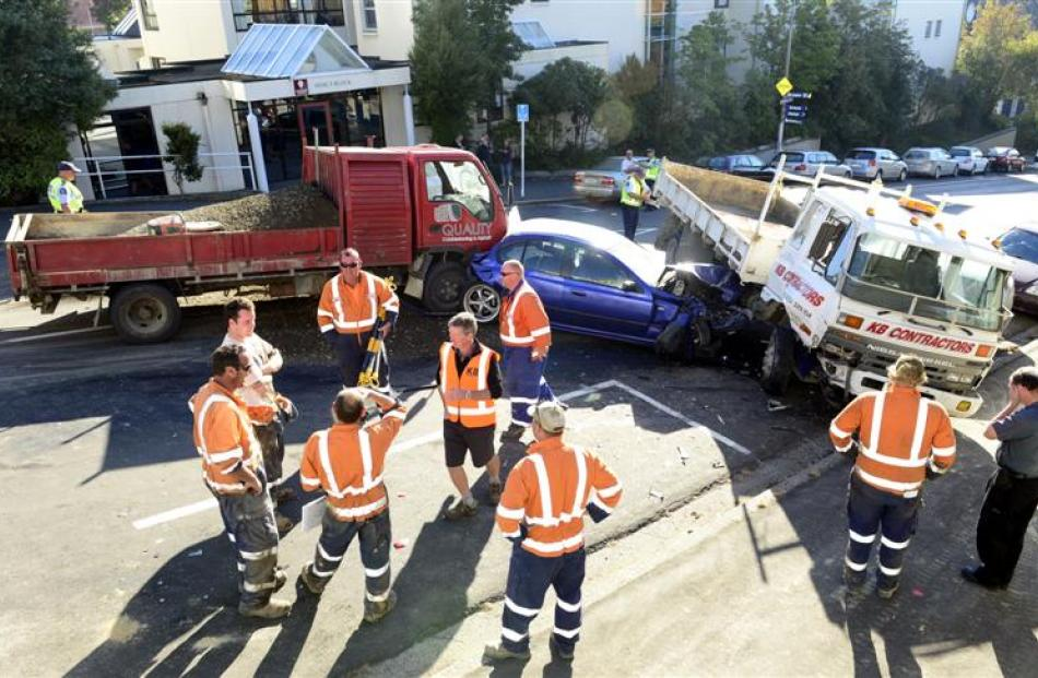 Emergency services at the scene of a vehicle pile-up on Rattray St yesterday morning. Photo by...