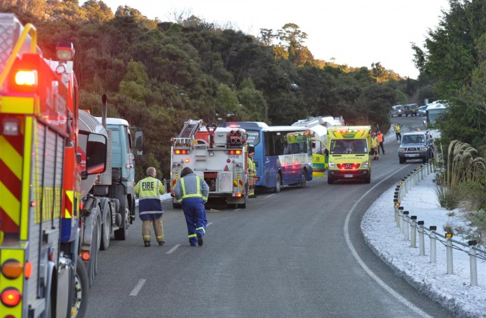 Emergency services at the scene of the Northern Motorway crash. Photo by Stephen Jaquiery