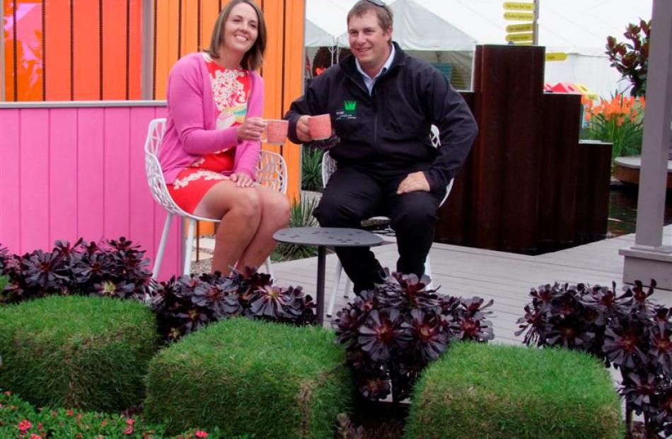 Emily McEwan, of East Taieri, and Gavin Slaughter, of Christchurch, in her prizewinning garden, '...