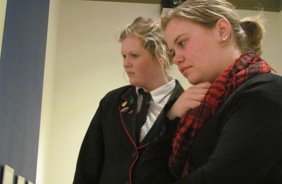 Emma Smith (17, left) and Hannah Stevenson (18) assess the artistic merits of artworks on display...
