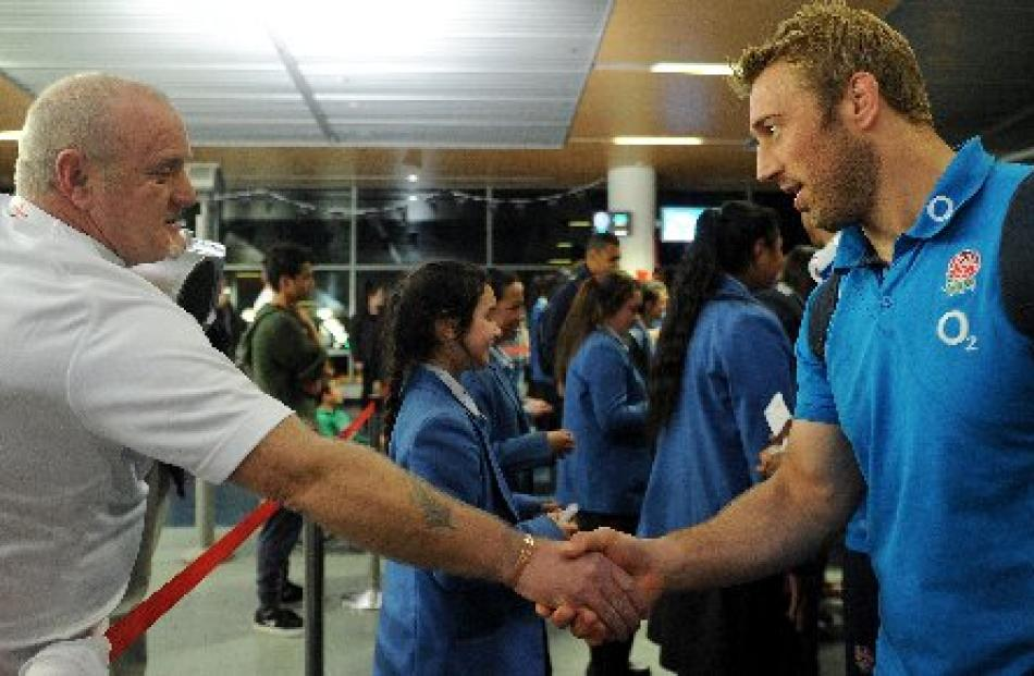England supporter Adam Morton sen, of Dunedin, shakes hands with England captain Chris Robshaw at...