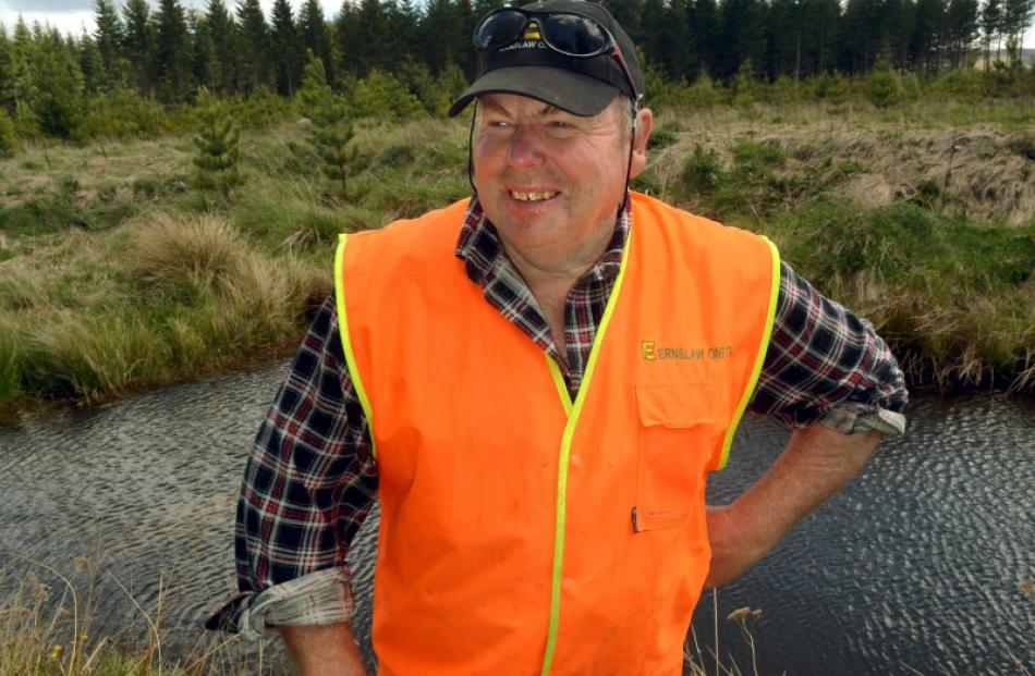 Ernslaw One Naseby forest manager Greg Kendall beside a koura pond in the forest. Photos by...