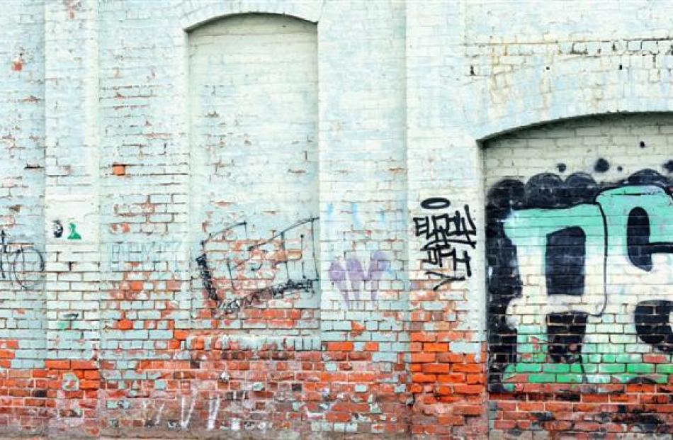 Examples of tagging around the Dunedin central business district. Photos by Craig Baxter.