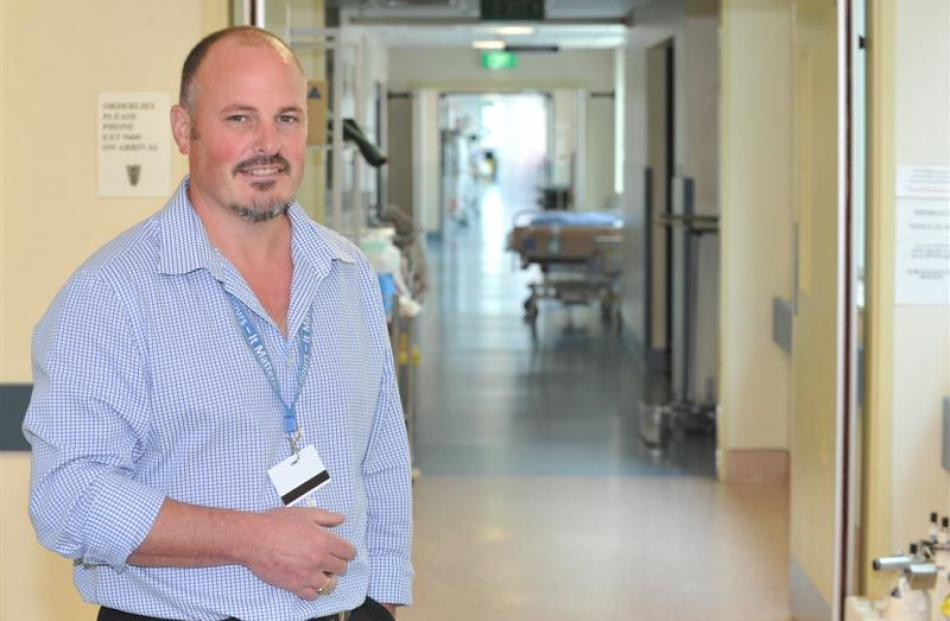 Facilities and site development manager Warren Taylor in the corridor of the surgical suite in...
