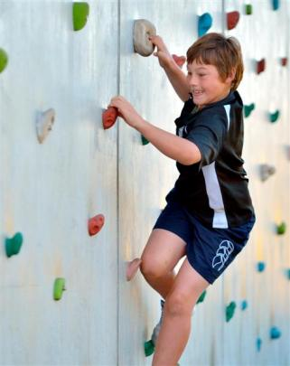 Fairfield School pupil Dominic Gullen (12) tries his hand at rock climbing. Photos by Gerard O...