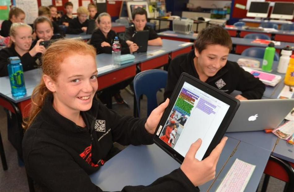 Fairfield School pupils Phoebe Aburn and J. Rock Maultby (both 12) get on with their web-based...