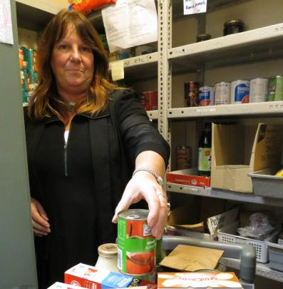Family Works social work supervisor Debbie Gelling at work in the organisation's foodbank, which...