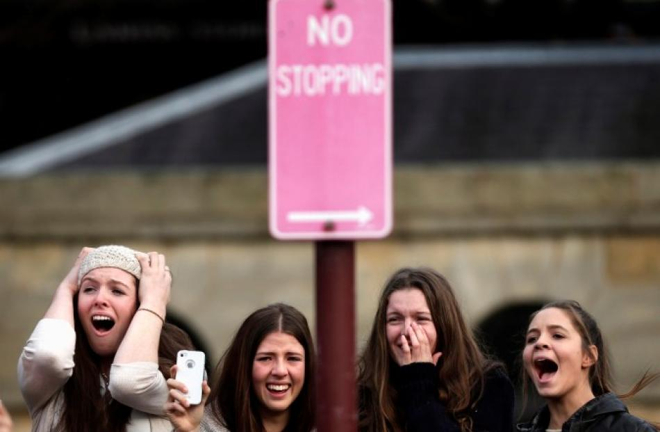 Fans react as Canadian singer Justin Bieber performs at an early morning promotional event in...
