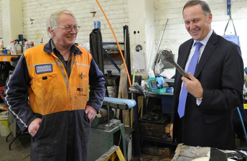 Farra Engineering worker Terry Smith talks to  Prime Minister  John Key when the  Mr Key  visited...