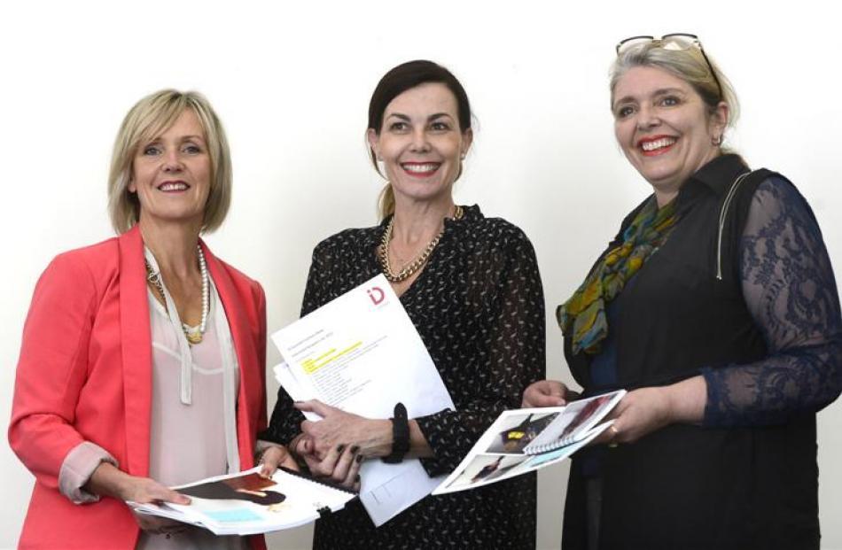 Auckland  fashion blogger Leonie Barlow (centre) gathers designer portfolios for selection in the...