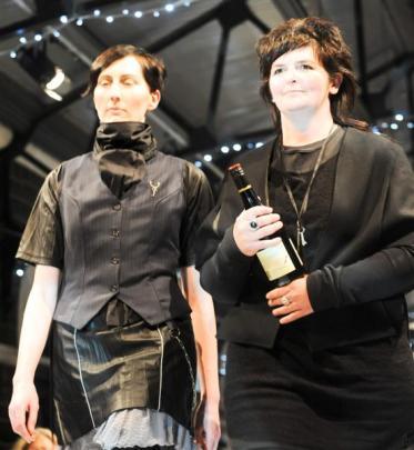 Fashion designer Jane Sutherland (right) strides along the catwalk at the 2012 iD Dunedin Fashion...