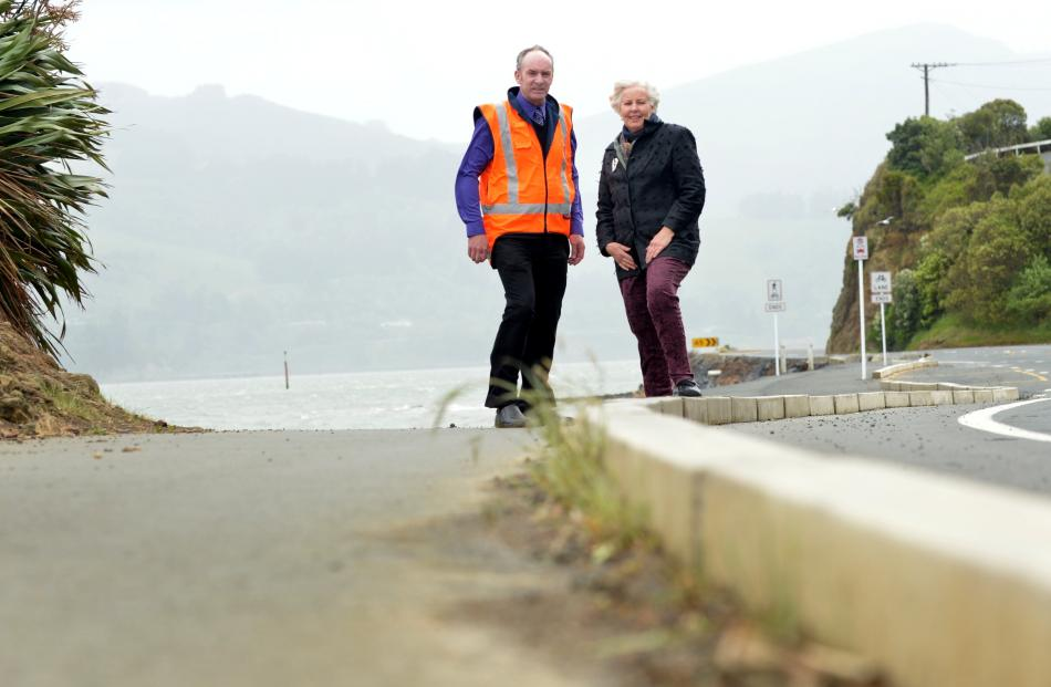 Council roading projects engineer Michael Harrison and Otago Peninsula Community Board Christine...