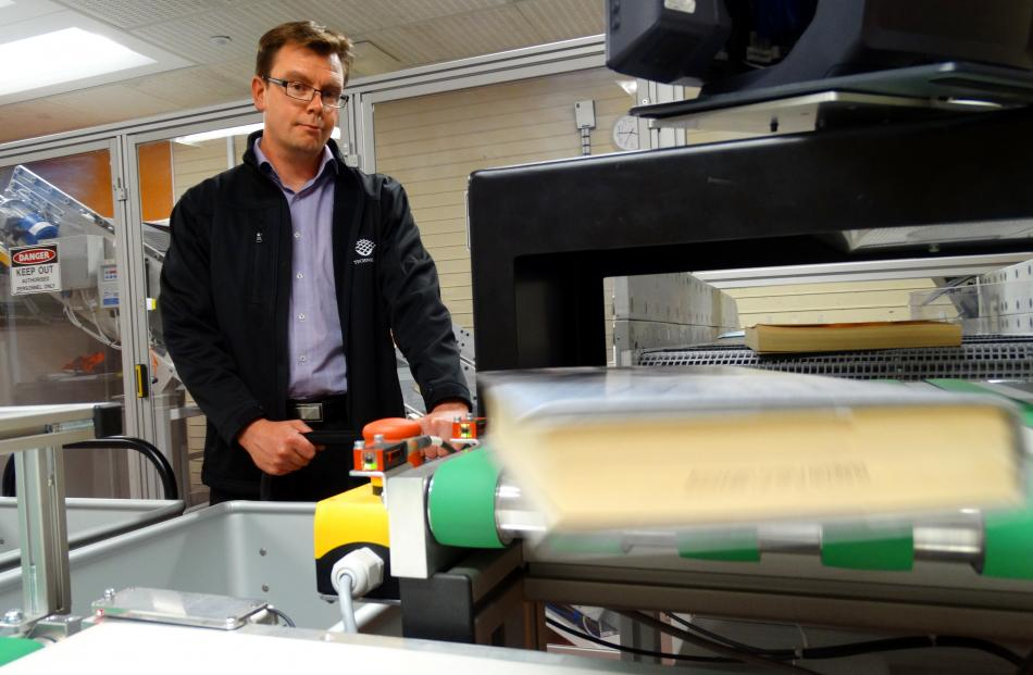 FE Technologies director Clint Agustsson tests the new sorting machine installed at the Dunedin...