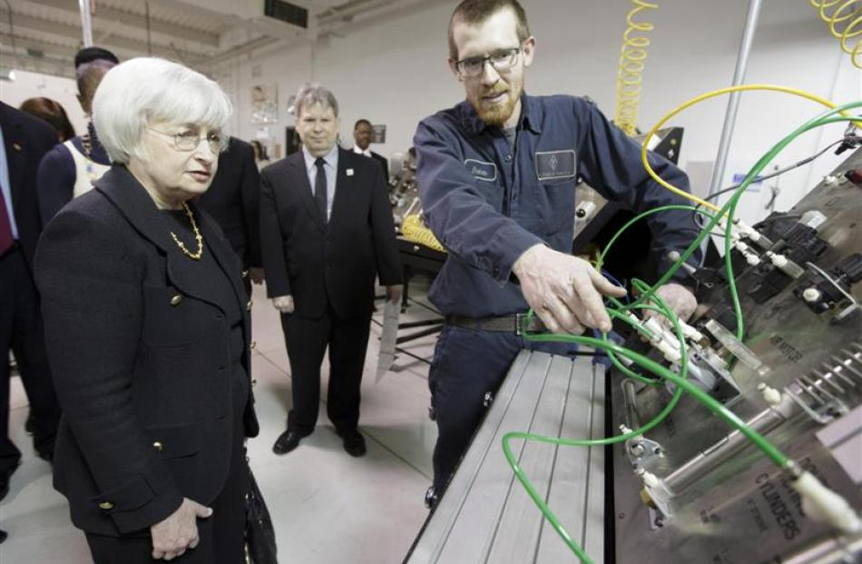 Federal Reserve chairwoman Janet Yellen speaks with student Baker Gregory as she tours the City...