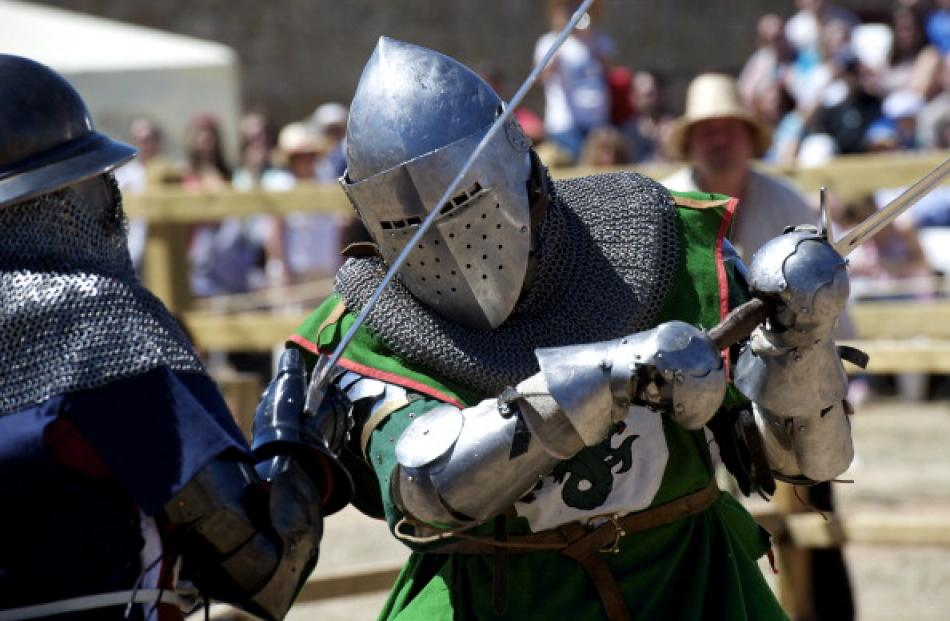 Female 'knights' from the US  (L) and Belgium battle during the International Medieval Combat at...