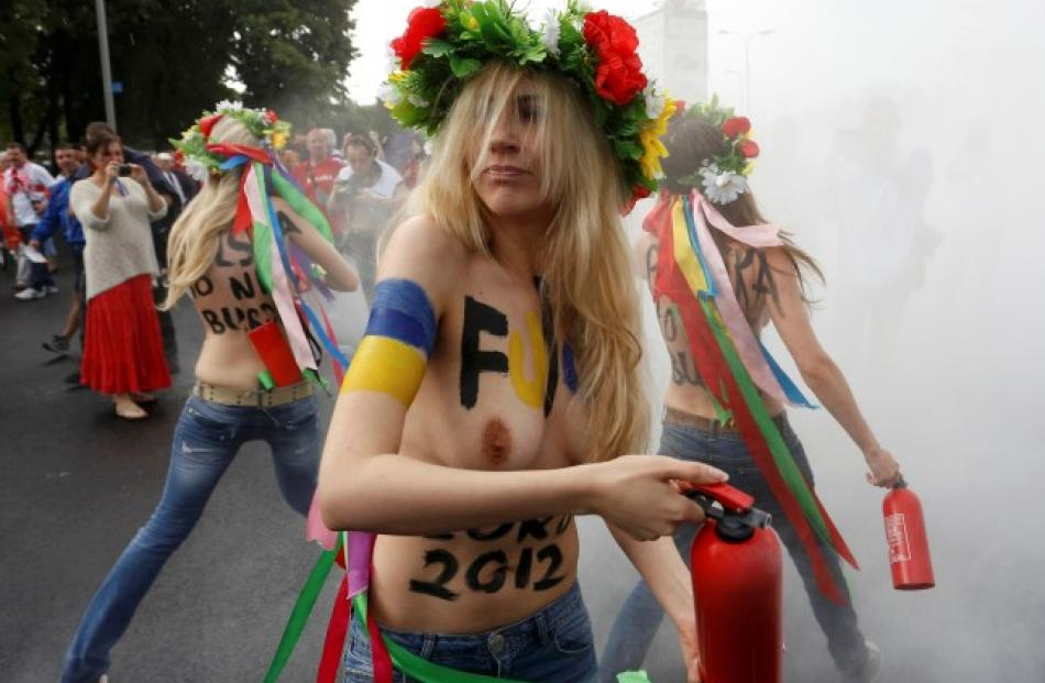 FEMEN activists protest against the Euro 2012 tournament outside a stadium in Warsaw, Poland....