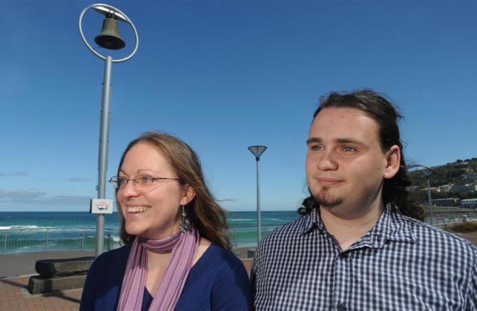Film-makers Nicole Schafer and Andrew Scott stand beside the St Clair Beach shark bell. Photo by...