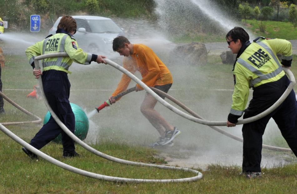 Qualified firefighters Seraya Figgins (left) and Sharon Brogan use their hose to gain posession...
