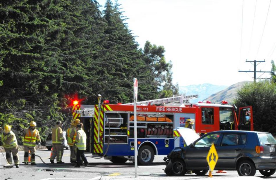 Fire Service personnel are on the scene following a collision between two vehicles at the...