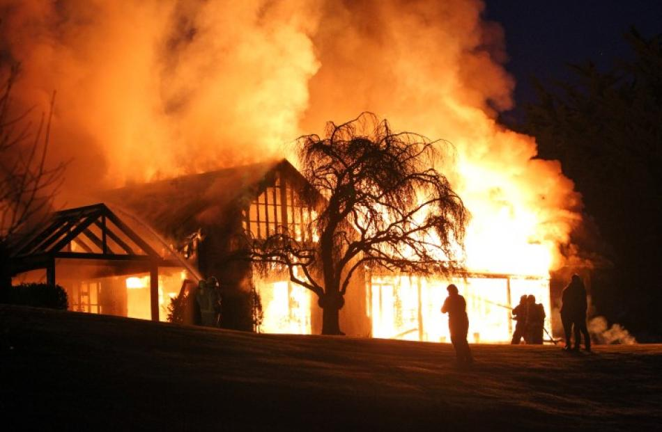 Firefighters had a battle on their hands with the blaze in Queenstown this morning. Photo: Blair...