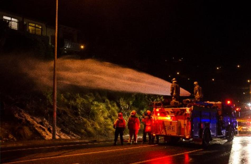 Firefighters tackle  the Queenstown Fire. Photo: Paula Fuentes