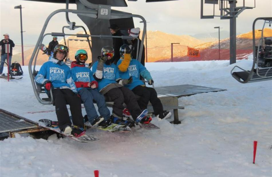 First on the chairlift at Coronet Peak for the 2014 season on Saturday were (from left) Cooper...